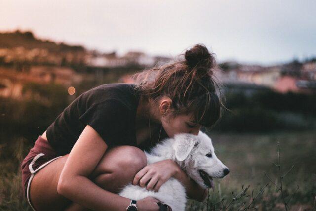 dog kiss and hug by woman